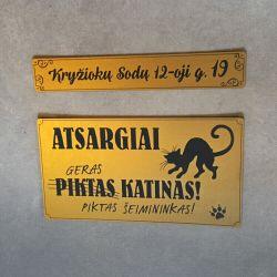 lenteles-ant-vartu-piktas katinas seimininkai